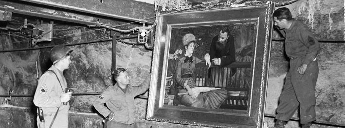 "In this April 25, 1945 image released by the U.S. National Archives, U.S. Army personnel stand by a painting called, ""Wintergarden,"" by French impressionist Edouard Manet, which was discovered in the vault in Merkers, Germany. Holocaust survivors and their relatives, as well as art collectors and museums, can go online beginning Monday, Oct. 18, 2010 to search a historical database of more than 20,000 art objects stolen in German-occupied France and Belgium from 1940 to 1944. (AP Photo/U.S. National Archives)"